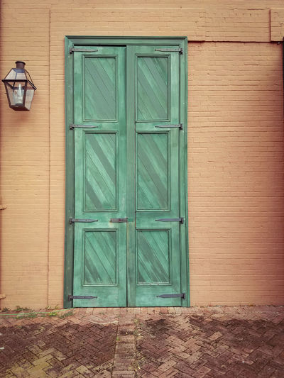 French Quarter Door and lantern lamp Door Closed Wood - Material Outdoors Safety No People Protection Day Built Structure Green Color Building Exterior Architecture Full Frame Close-up French Quarter New Orleans French Quarter Architecture Green Color Lantern Lamp Lantern Firehouse Louis Armstrong Park Building Painted Brick Painted Brick Building The Graphic City Colour Your Horizn The Architect - 2018 EyeEm Awards