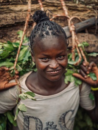 Ethiopia Tribe Africa Ethiopian Photography 🇪🇹 African Ethiopian Portraits Omo Valley Portrait Photography Tribal Portrait Of A Woman Omo Valley Portrait Looking At Camera Smiling Casual Clothing One Person Lifestyles Front View Nature Child Real People Childhood Happiness Growth Standing Day Land Emotion Hairstyle