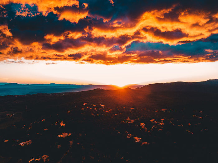 Above The City Above The Clouds Beauty In Nature Clouds And Sky Cloudy Day Drone  Dronephotography Droneshot Idyllic Landscape Mountain Nature No People Orange Color Outdoors Scenics Sea Silhouette Sky Sun Sunlight Sunset Tranquil Scene Tranquility