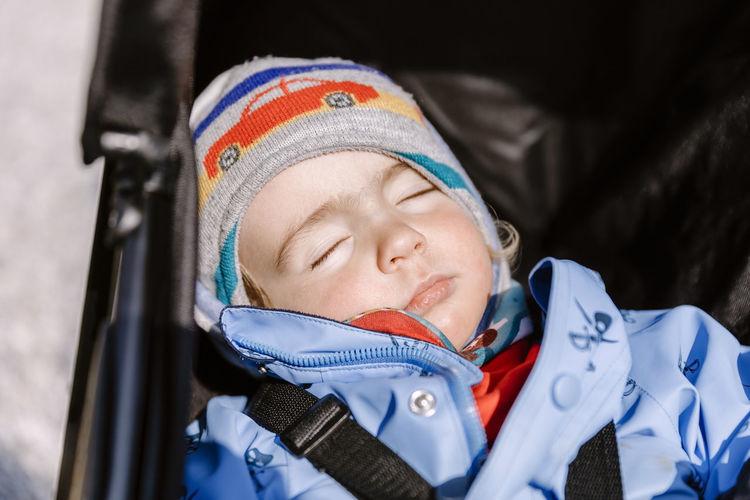Close-Up Cute Girl Sleeping In Stroller