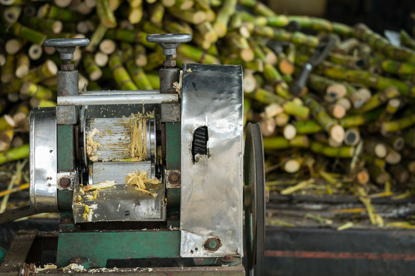 Sugarcane juice machine at street of Kota Baharu, Malaysia. Its an extremely common street drink in Asean. Drink Fiber Healthy Juice Machine Press Processing Squeeze Sugarcane Summer Sweet