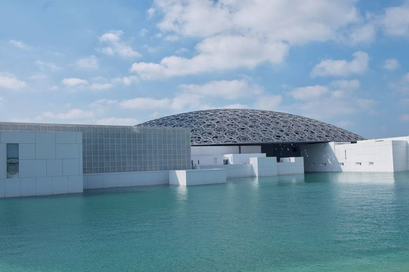 Louvre Abu Dhabi - January 14, 2018: A picture taken in day light, Louvre Abu Dhabi, UAE. Editorial  Museum Art Arts Culture And Entertainment Museum Of Natural History Louvremuseum Louvre Water Sea Summer Cloud - Sky Protection Swimming Pool Day