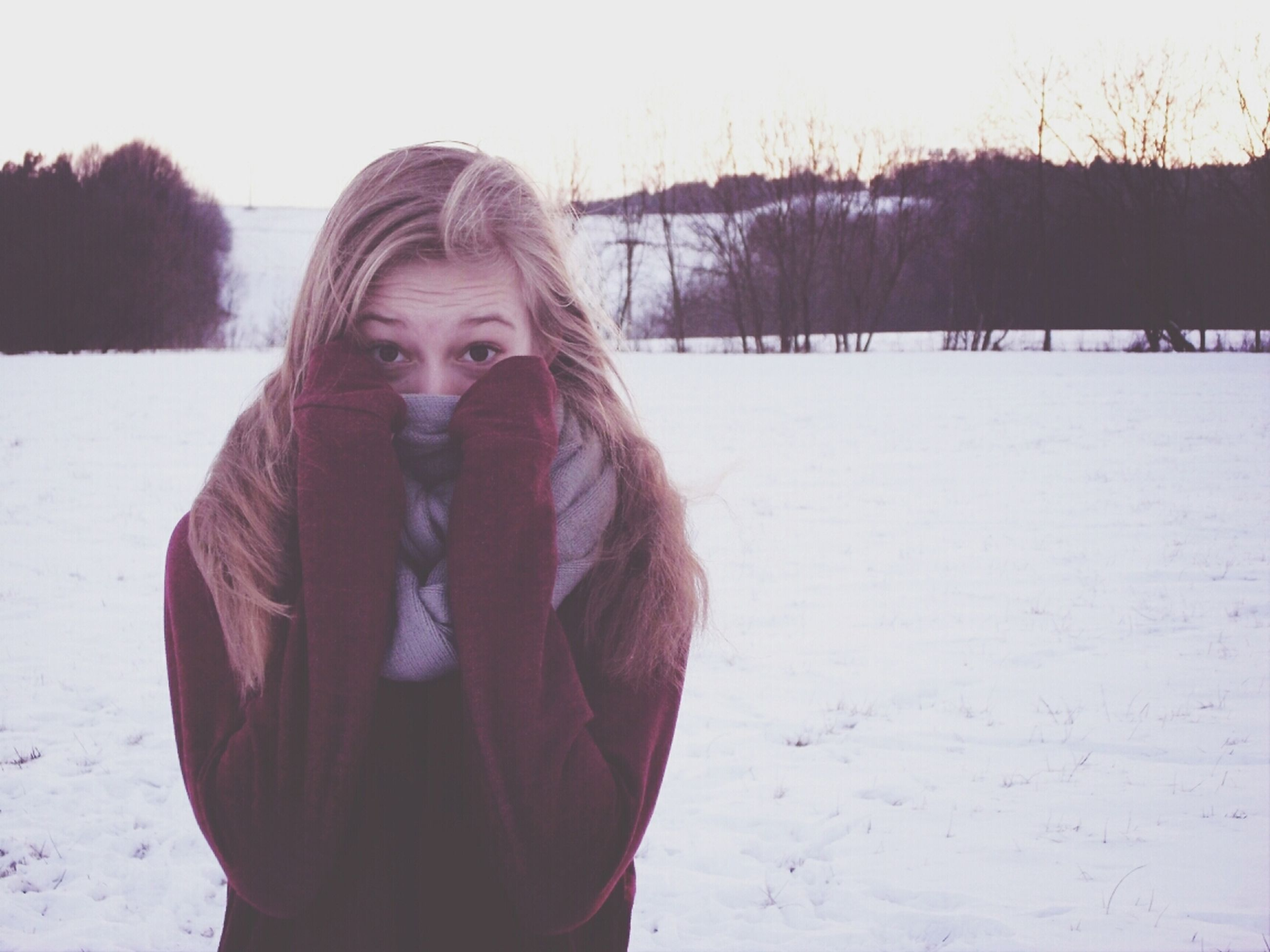 winter, snow, cold temperature, season, lifestyles, person, warm clothing, leisure activity, field, portrait, weather, looking at camera, standing, front view, covering, young adult, landscape, nature