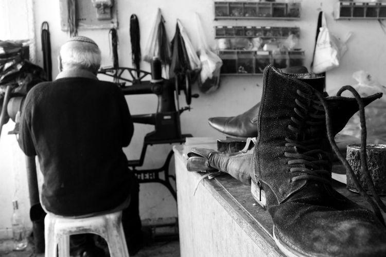 Shoemaker at workshop