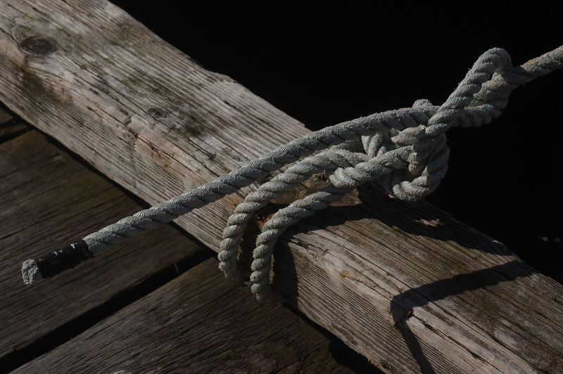 High angle view of rope tied up on wood