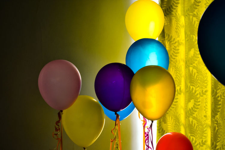 Close-Up Of Colorful Helium Balloons At Home