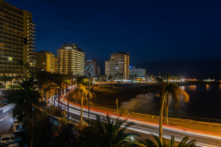 Long Exposure City Puerto De La Cruz Tenerife Night City Cityscape Urban Skyline Illuminated Modern Skyscraper Downtown District Long Exposure Light Trail Business Finance And Industry Tail Light Street Light Vehicle Light Traffic Jam Traffic Rush Hour City Street