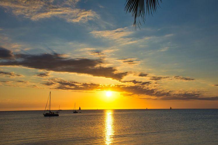 Sunset on Lemons Bay Beach Water Sunset Sky Sea Beauty In Nature Cloud - Sky Scenics - Nature Nautical Vessel Transportation Tranquility Horizon Over Water Horizon Orange Color No People Idyllic Sun Nature Tranquil Scene Waterfront