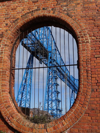 Low angle view of bridge seen through window