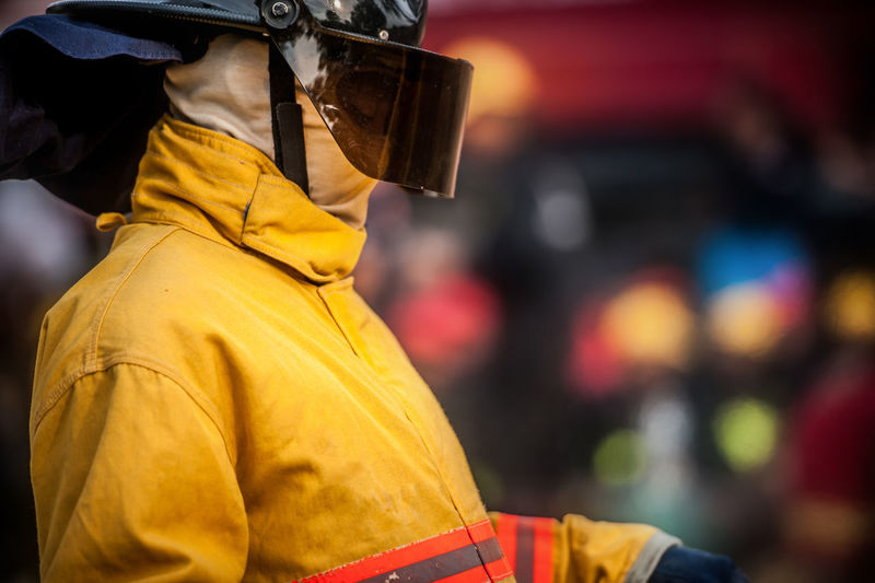Close-up of firefighter wearing mask and helmet