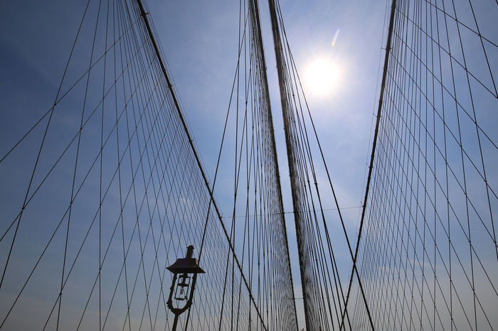 Bridge Brooklyn Bridge / New York Construction Day Historical Building Sky Stable Steel Cable Steel Net Sunbeam