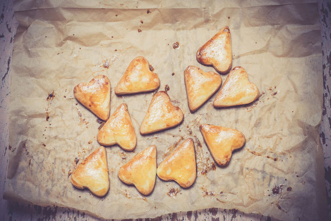 Heart shape cookies on the baking paper Baked Bakery Baking Paper Bread Close-up Cookies Crusty Day Dessert Directly Above Food Food And Drink Freshness Gold Healthy Eating Heart Shape Heart Shape Cookies Homemade Indoors  Kitchen No People Ready-to-eat Sweet Food Yummy
