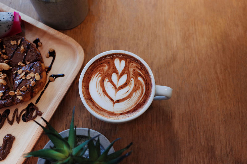 Hot Coffee on wooden table with chocolat on bread Food And Drink Coffee Coffee - Drink Drink Cup Mug Coffee Cup Refreshment Still Life Table Food Hot Drink Frothy Drink Cappuccino Freshness Indoors  Froth Art Wood - Material Kitchen Utensil Leaf Latte No People Crockery Breakfast