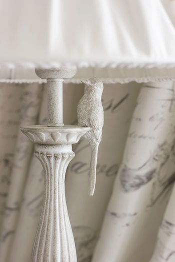 Close-up of tied hanging on white at home