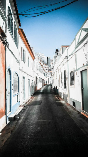 Algarve Portugal Alley Architecture Building Building Exterior Built Structure City Clear Sky Day Diminishing Perspective Direction House Nature No People Outdoors Residential District Row House Sky Street Sunlight The Way Forward Transportation Window