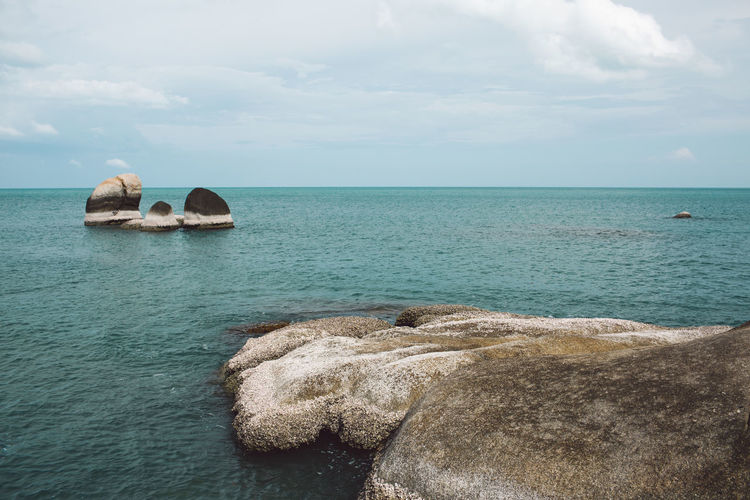Sea Sky Water Scenics - Nature Horizon Horizon Over Water Rock Beauty In Nature Cloud - Sky Tranquil Scene Tranquility Solid Rock - Object Nature Land Day Idyllic Rock Formation Beach No People Outdoors Turquoise Colored