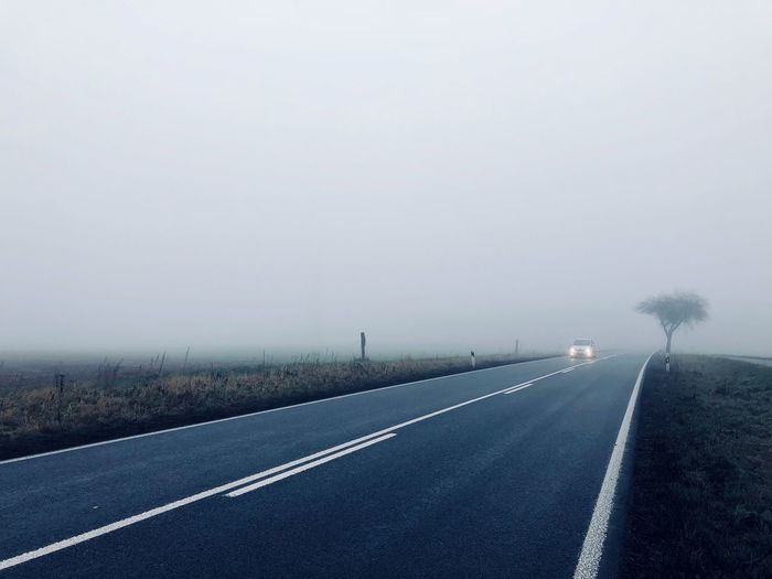 Misty Landscape Misty Tree Landscape Transportation The Way Forward Road Foggy Day Foggy Car Car Headlights Spooky Atmosphere Country Road Loneliness In The Middle Of Nowhere Asphalt Blueish