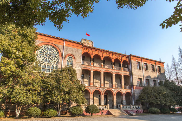 Soochow University Arch Travel Destinations Tourism Architecture History Travel Outdoors Built Structure Day Tree Vacations Statue No People City Sky Building Exterior King - Royal Person Politics And Government