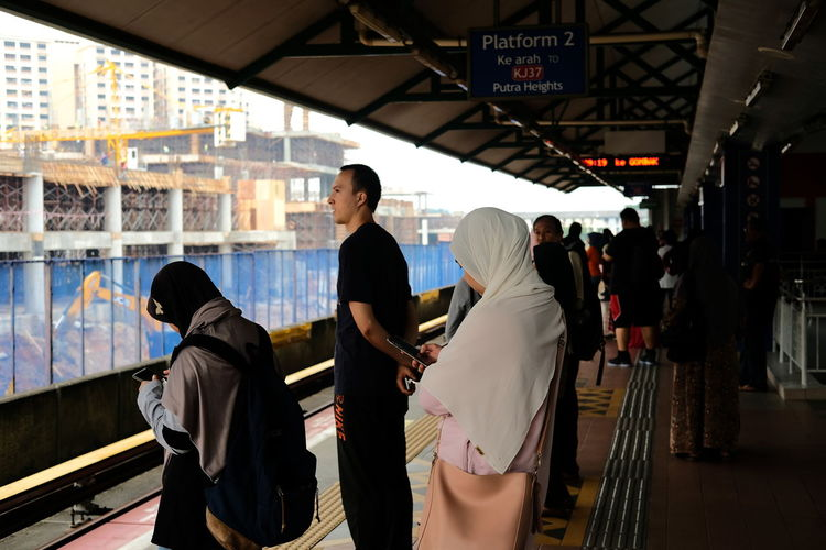 People standing on railroad station platform
