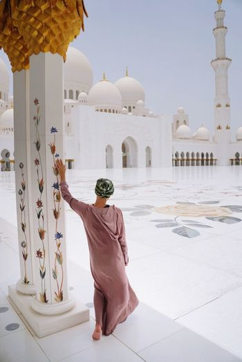 Woman visiting Sheikh Zayed Mosque Abu Dhabi Islamic Architecture Sheikh Zayed Grand Mosque Abu Dhabi Grand Mosque Muslim Architecture Built Structure Religion One Person Travel Destinations Dome Belief Tourism Building Exterior Spirituality Rear View Place Of Worship Arch