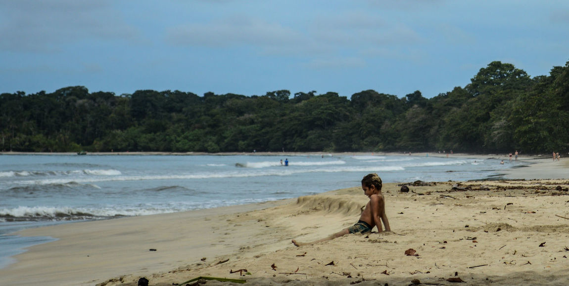 Cahuita National Park Children Costa Rica Relaxing Vacations Beach Beauty In Nature Cahuita Child Childhood Day Growth Kid Nature One Person Outdoors Real People Sand Scenics Sea Shore Summer Tree Water