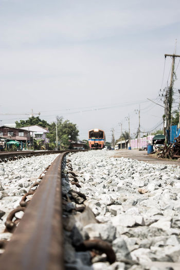 Cable Connection Day Direction Electricity  Metal Mode Of Transportation Nature No People Outdoors Power Supply Rail Transportation Railroad Track Selective Focus Sky Solid Surface Level Technology The Way Forward Track Transportation