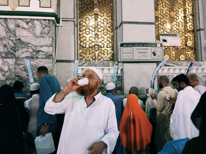 A man drinking zam-zam water at Masjidil Haram, Makkah. Masjidilharam Man Drinking Water Streetphotography Xiaomiphotography Mobilephotography Travalogue Moments Of Life A Group Of People Adults Only Adult Only Men Store Men Customer  Barber Real People People Lifestyles City