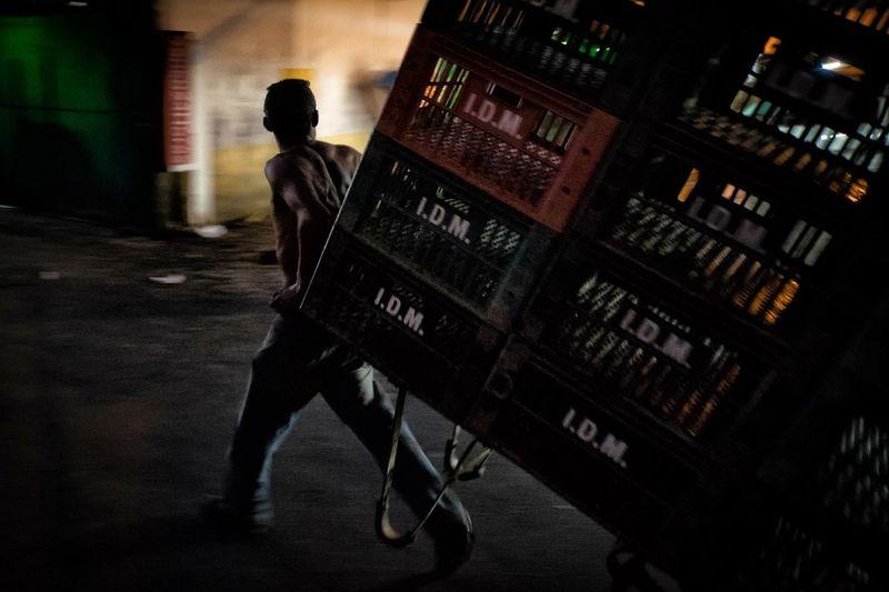 Man Pulling Plastic Crates