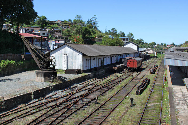 Train station with old rusty crane, storehouses and wagons in Hatton, Sri Lanka Ancient ASIA Building Exterior Built Structure Corrugated Iron Crane Diagonal Hall Hattori Historic India Old Rail Transportation Railroad Track Railway Shed Sri Lanka Station Storehouse Switch Technology Tracks Train Wagon  Warehouse