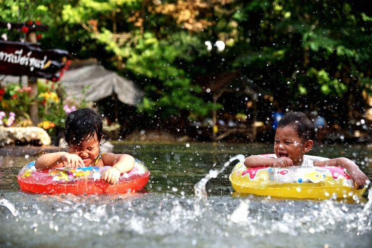 Children happy with the swim Water Childhood Child Men Enjoyment Males  Leisure Activity Nature Splashing Outdoors Girls Motion Fun Boys Day Lifestyles