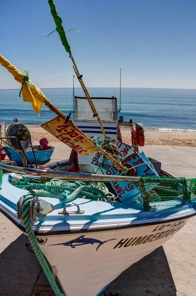 Fishing boat Algarve Portugal Beach Life Lifestyle Blue Colorful Culture And Tradition Fishing Boat Food Horizon Horizon Over Water Nautical Vessel Sea Sky Tourism Water