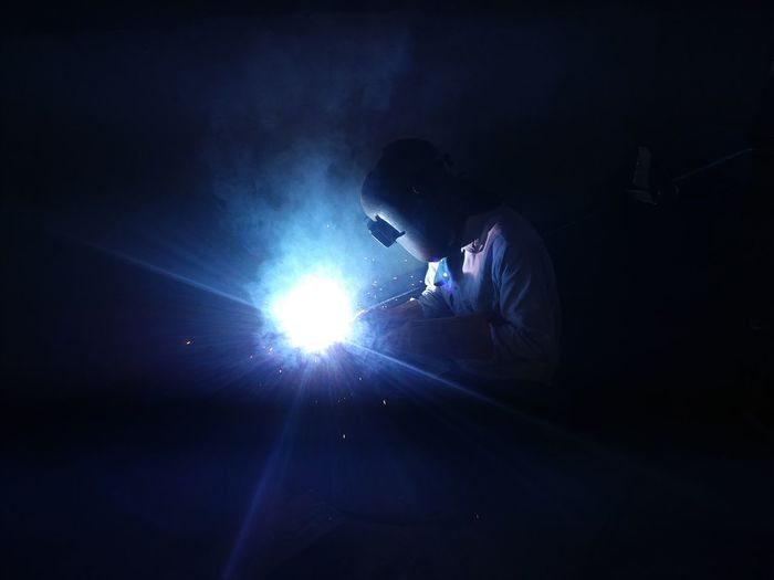Male Welder Welding In Factory