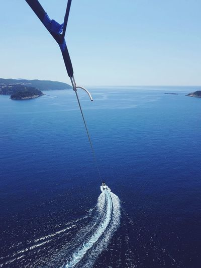 Rope attached to boat sailing in sea
