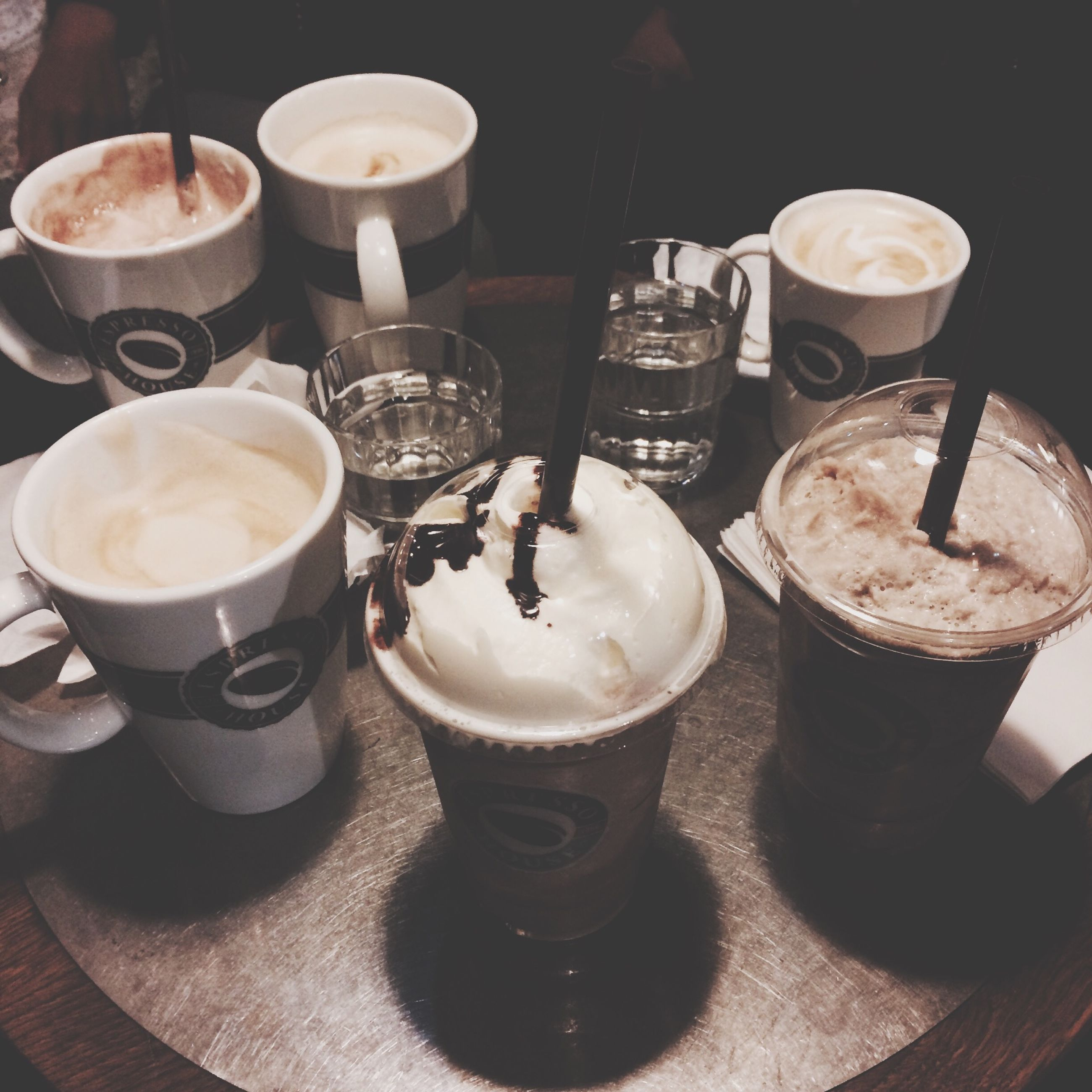 food and drink, drink, freshness, refreshment, indoors, table, coffee - drink, coffee cup, still life, saucer, frothy drink, drinking glass, food, coffee, close-up, cappuccino, beverage, cup, high angle view, spoon