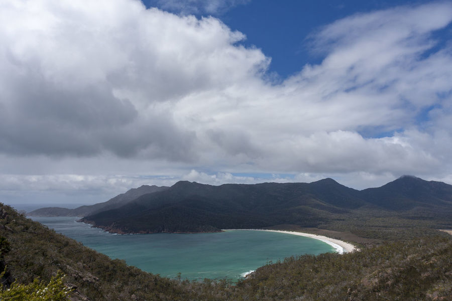 Wine Glass Bay, Tasmania, Australia. Tasmania Tassie Tasmanian Australian Landscape Australia Australian Freycinet Freycinet National Park Coles Bay Wineglass Bay Wine Glass Bay  Summer Travel Destinations Mountain Landscape Cloud - Sky Water Sea Beach No People Outdoors Sand Vacations Scenics Nature Day Beauty In Nature Sky
