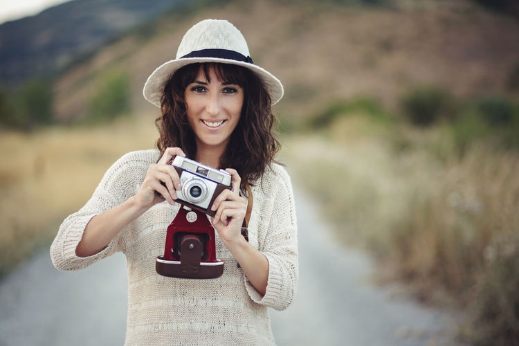 Camera - Photographic Equipment Fun Happy Lifestyle Portrait Of A Woman Tourist Travel Woman Camera - Photographic Equipment Happiness Leisure Activity Nature Photographer Photography Photography Themes Portrait Smiling Summer Tourism Traveler Woman Portrait Young Women