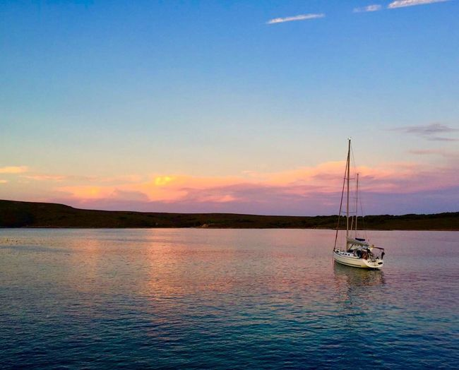 Water Sky Nautical Vessel Transportation Beauty In Nature Mode Of Transportation Scenics - Nature Cloud - Sky Tranquility Waterfront Nature Sea Tranquil Scene Sunset No People Sailboat Reflection Idyllic Outdoors