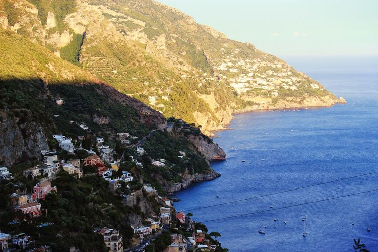 when light and darkness embrace Cliff Coastline Darkness And Light EyeEm Gallery Horizon Over Water Idyllic Mountain Nature No People Positano Scenics Sea Vacations Water