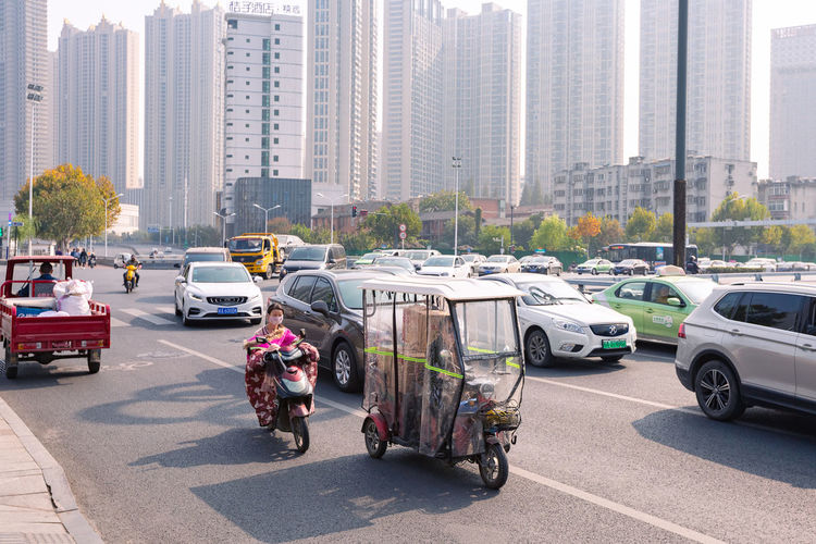 Vehicles on city street by buildings