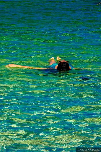 Título: Toca mi mano/Touch my hand. Lugar: Formentera (Spain) Cámara: Panasonic DMC TZ60 f/5.6 44.8 mm 1/640 s 100 Jun 7, 2015 Marcus Populus Adult Blue Lifestyles Nature One Person Real People Sea Vacations Water Waterfront