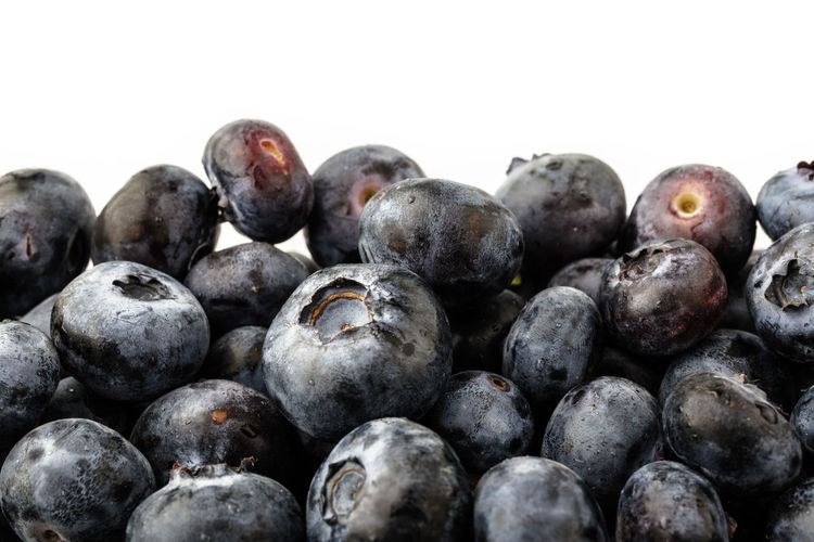 Full frame shot of blueberries against white background