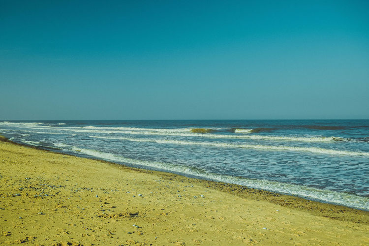 Sea Beach Water Horizon Horizon Over Water Land Sky Scenics - Nature Beauty In Nature Clear Sky Nature Tranquil Scene Tranquility Outdoors Beach Photography Sand Space For Text Space For Copy Motion Leading Lines Copy Space No People Wave Idyllic