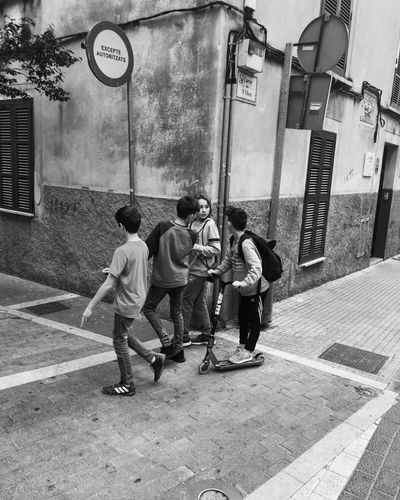 Zza rogu czasu Cobbled Streets Hood #spain #children Men City Architecture Building Exterior Group Of People Full Length Street People Outdoors Road Lifestyles Day First Eyeem Photo