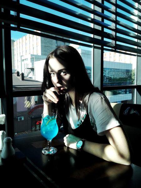 tatianakipka Blue Blue Sky Blue Color Bluedrink Russian Girl Krasnodar Structure Young Women Sitting Women City Window Table Window Sill Window Frame The Street Photographer - 2018 EyeEm Awards