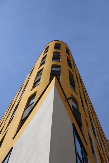 Low Angle View Sky Built Structure Architecture Building Exterior Clear Sky No People Tall - High Outdoors Nature Sunlight Copy Space Building Day Blue Pattern Tower Yellow City Shape