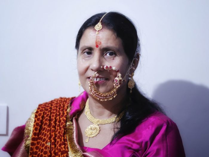 Portrait of woman in sari and jewelry at home