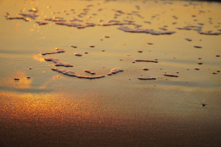 High angle view of wet sand on beach
