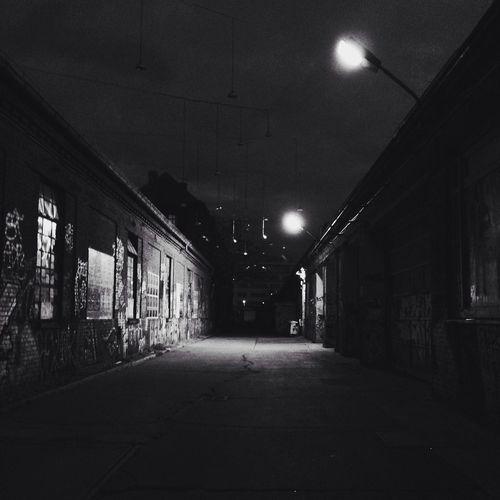 Empty illuminated street at night