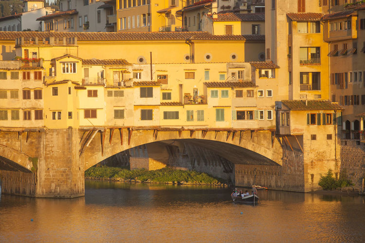 Ponte Vecchio Over River On Sunny Day