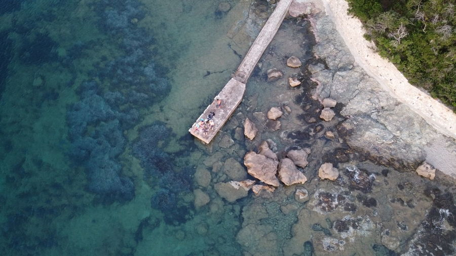 High angle view of rocks on shore